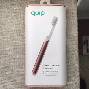 Unopened quip toothbrush rose gold copper color